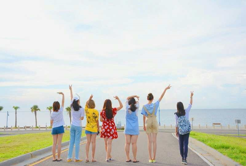 group of girls posing on the road in front of lake Pontchartrain