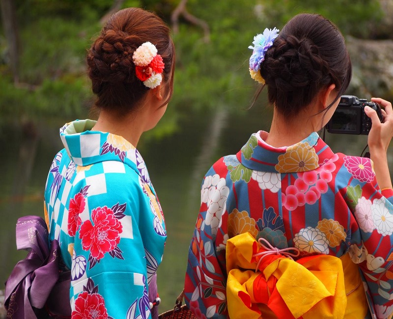 Girls wearing Kimonos taking a picture