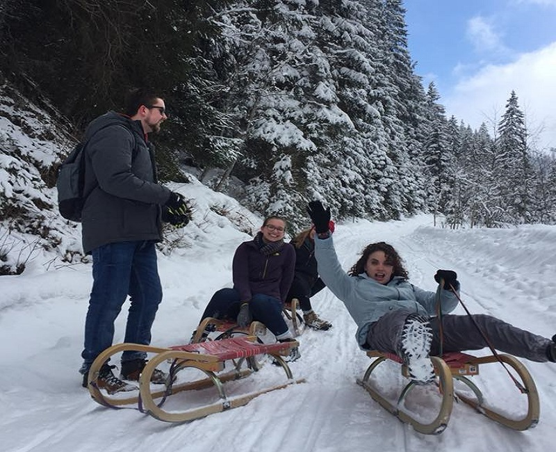 Students sledding in Austria