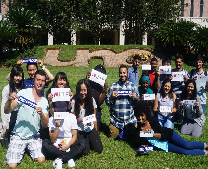 students posing with signs
