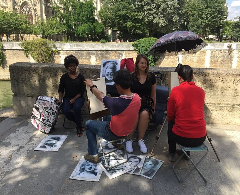 Students having their caricatures drawn in France