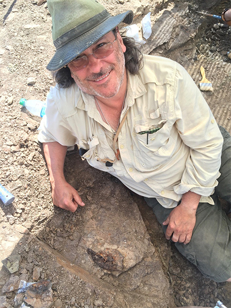 David Burnham on digging site.