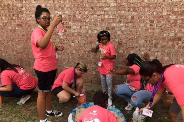 The weeklong GE Girls camp held at the University of New Orleans introduces campers to various STEM careers, including computer programming and forensics, through hands-on activities such as a session called outdoor chemistry.