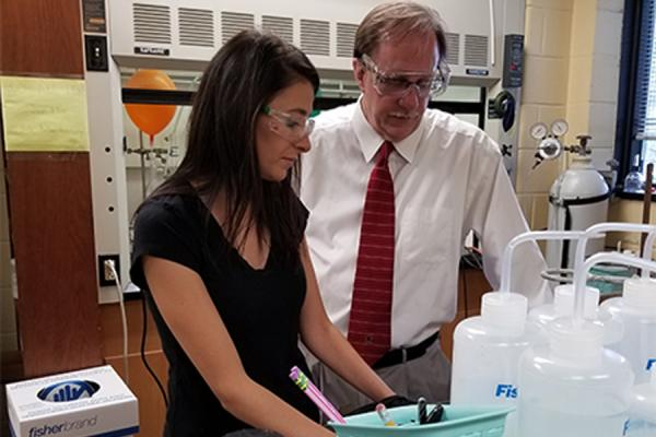 University of New Orleans chemistry professor Mark Trudell (right) and doctoral student Jumanah Hamdi work in the lab.