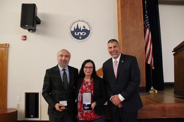 President John Nicklow(far right) with two of the three recipients of the University's annual awards, (l-r)Parviz Rastgoufard  and Karen Thomas. Margaret Davidson is not pictured.