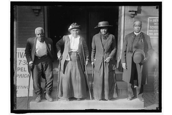 Four attendees at the convention of formerly enslaved people held in 1916 in Washington, D.C.  (L-R) Lewis Martin, Martha Banks, Amy Ware, and Reverend S.P. Drew, who was born free. (Library of Congress)