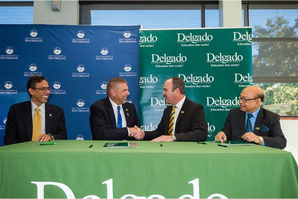 (l-r) Mahyar Amouzegar, UNO provost and senior VP academic affairs; UNO President John Nicklow; Delgado Interim Chancellor William Wainwright; and Mostofa Sarwar, Delgado interim vice chancellor of academic affairs and provost, at the Jan. 24 signing ceremony.