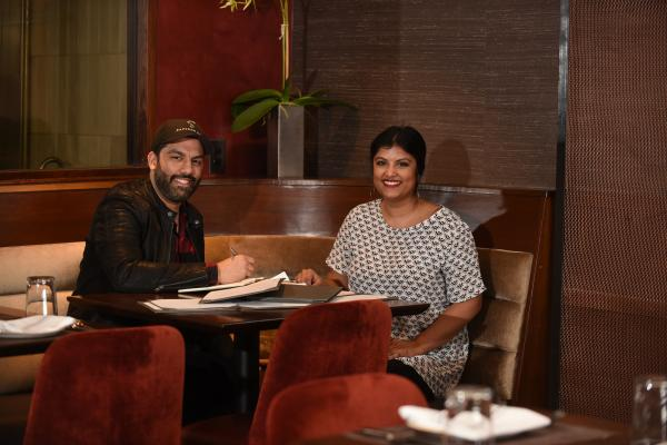 University of New Orleans alumni Ashwin Vilkhu and his younger sister, Pranita Vilkhu, along with their parents own the popular restaurant Saffron