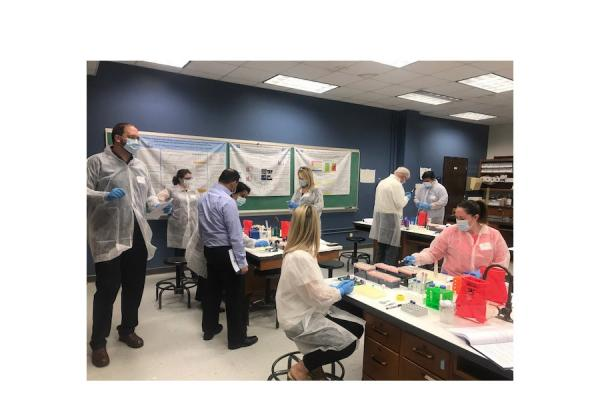 Scientists from public and private sector labs test DNA samples using the SpermTrap process during a forensics workshop Monday sponsored by the University's Advanced Materials Research Institute (AMRI) and InnoGenomics Technologies.