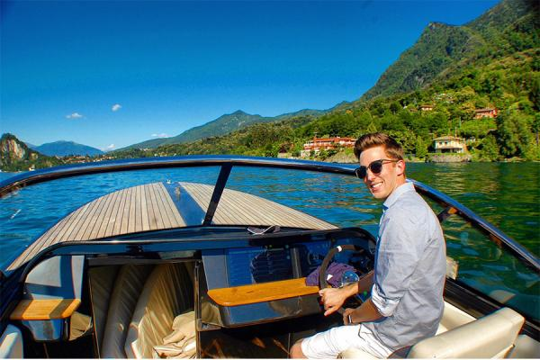 University of New Orleans student Nigel Watkins is at the wheel of a Vita Yacht in Lago Maggiore, Italy.