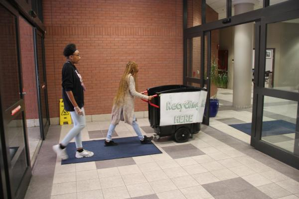 Two of the university's most visible green initiatives are a new recycling team and the recent installation of thousands of energy efficient bulbs around campus.