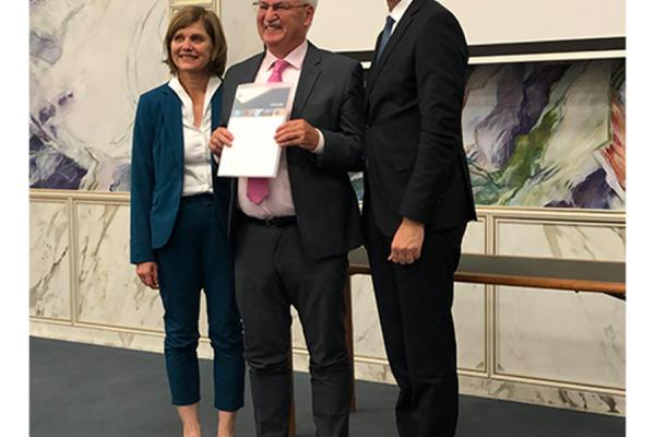 "Center Austria director Guenter Bischof (center) received the ""Scholar of the Year Award"" from the Austrian state of Vorarlberg during a ceremony earlier this month in Bregenz, Austria with Markus Wallner (right), governor of Vorarlberg, and Lt. Gov. Barbara Schoebi-Fink."