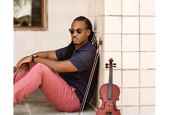 "University of New Orleans alumnus Trenton ""T-Ray"" Thomas is charting a music career with a love of the violin and an outside-the-box playlist."