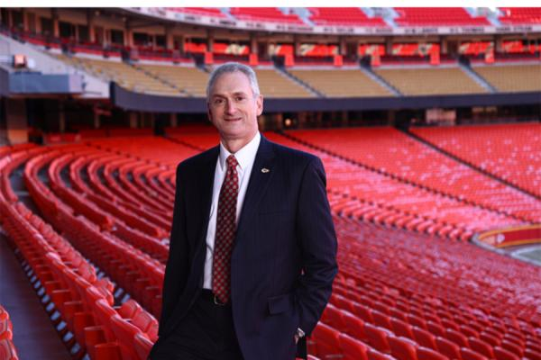 University of New Orleans alumnus Dan Crumb, CFO for the Kansas City Chiefs, stands in Arrowhead Stadium.