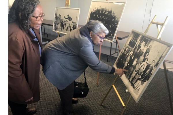 Jenny Branch, left, and her sister Edna Branch look at pictures included in the Orleans Parish School Board Collection housed at the University of New Orleans' Earl K. Long Library.