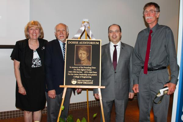 From left to right: Helen Holzenthal, Associate Dean Kim Jonvanovich, Dean Taskin Kocak, Till Dohse stand by the plaque dedicating the auditorium to Fritz-Egbert Dohse.