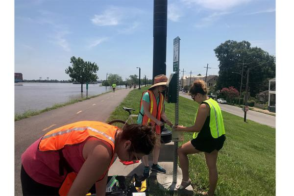 Tara Tolford (right), research associate in the University's Transportation Institute, was awarded $248,000 to collect and study data on bicyclists and pedestrians. She and research assistants Marin Tockman and Antonia White-Barstow install a counter.