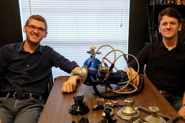 University of New Orleans mechanical engineering students Daniel Elfert (left) and Mitchell Maurin designed and built a hybrid rocket engine.