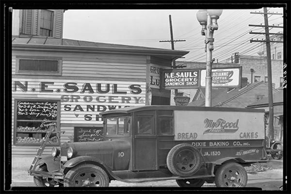The Midlo Center for New Orleans Studies is creating a new oral history project focusing on family businesses in New Orleans. A New Orleans street corner is pictured circa 1936. (Walker Evans, Library of Congress).
