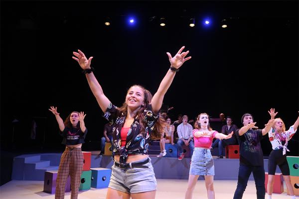 "Raegan Rozas as ""Niki"" in the UNO theater production, ""Dark Nights: the musical."""