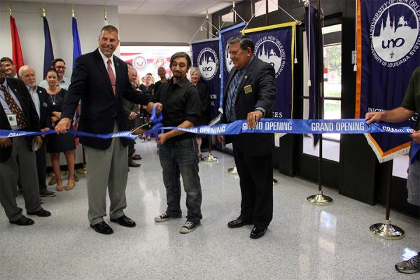 UNO President John Nicklow, student Miguel Olivero and Col. Joey Strickland, secretary of the Louisiana Department of Veterans Affairs, participate in a ribbon-cutting to open UNO's Veterans Service Center in 2017.