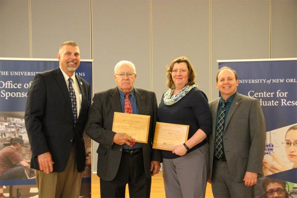 President John Nicklow (far left) stands with award winners Allan Millett, Wendy Schluchter and Matt Tarr, vice president for research and economic development, during the annual Achievements in Research, Creativity and Scholarship awards ceremony.