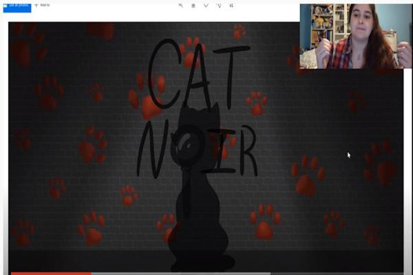"University of New Orleans student Victoria Preston explains her artist role in developing the ""Cat Noir"" murder mystery game."