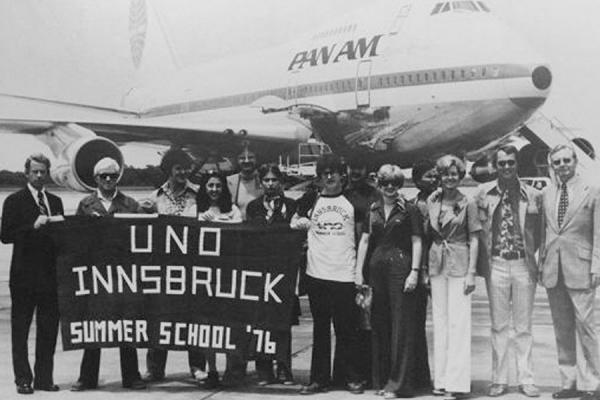 Students, faculty and administrators pose for a picture in 1976 before boarding the airplane for that inaugural summer session in Innsbruck, Austria.